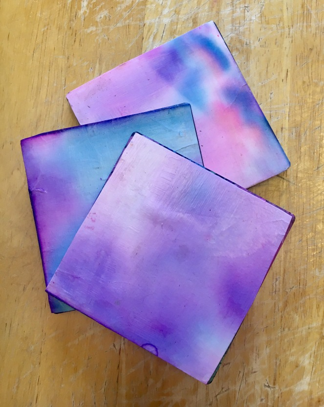 DIY coasters made out of kid paintings and prints