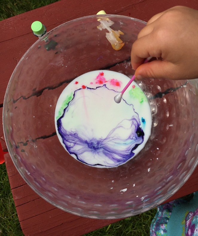 Magic milk from milk, dish soap and food coloring