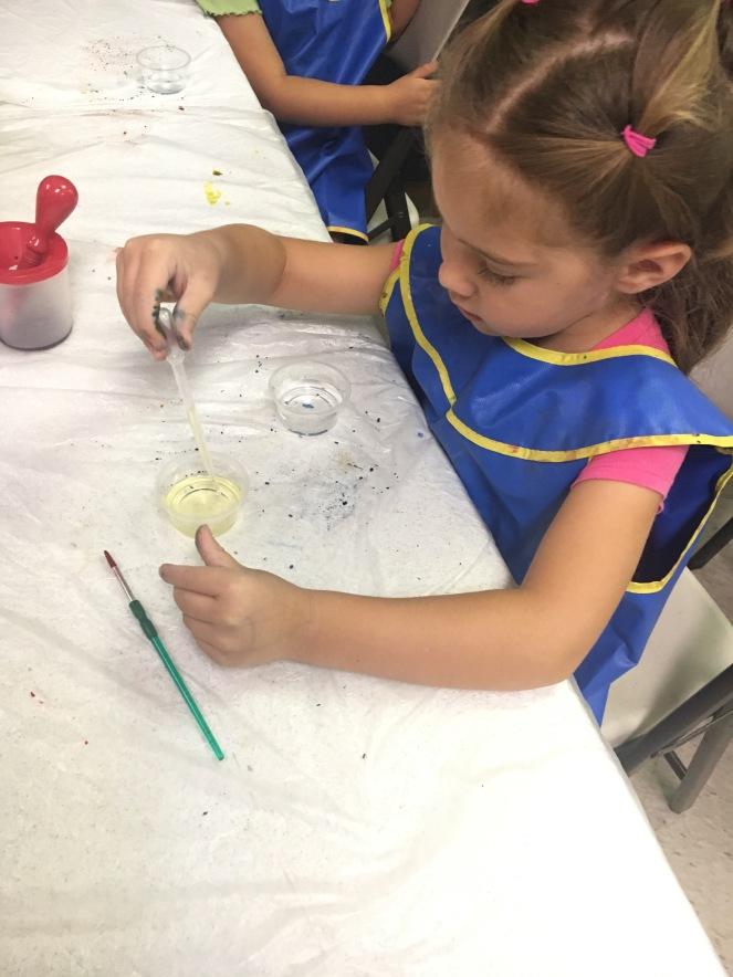 Mixing oil and water in art class